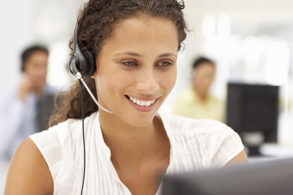 Careers at George Banco Guarantor Loans - Image is a Smiling Woman in a call centre